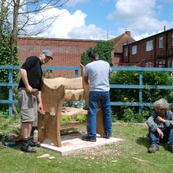 volunteers working on new benches in the grounds of st sidwells