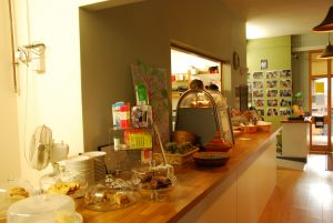 picture of the cafe counter displaying the home made cakes.