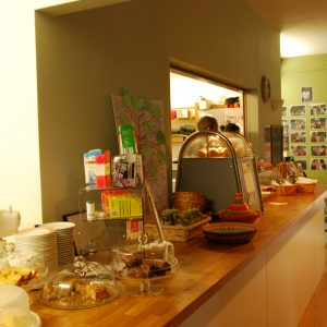 the cafe counter with a selection of cakes on show