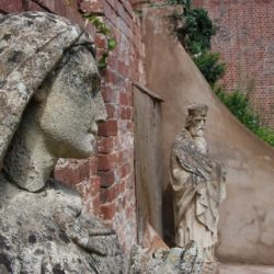 two stone carved statues