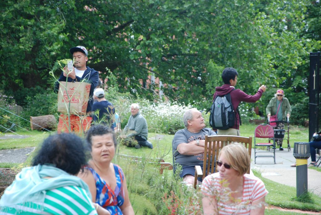group of people enjoying the open day in the garden at St Sidwells