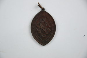 RAMM Guild of St Sidwells medal back - Ref. Royal Albert Memorial Museum and Art Gallery, Exeter